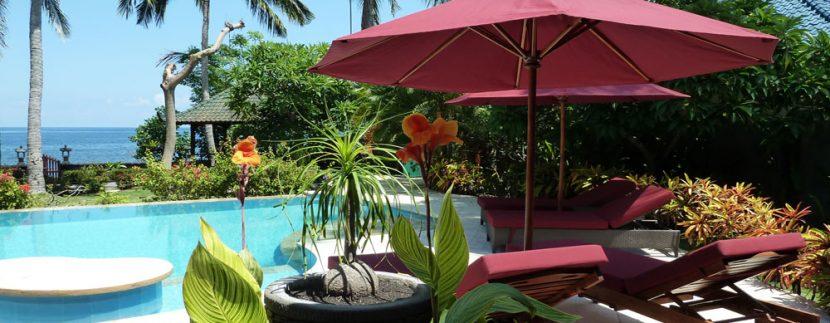 bali-beachfront-villa-for-sale-sun-chairs
